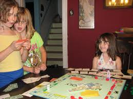 kids playing games monopoly