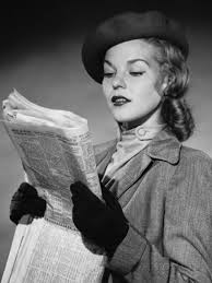 woman reading a paper