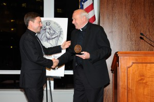 Father David T. Link, [right] a lawyer-turned-priest, is recipient of the James Keller Award.