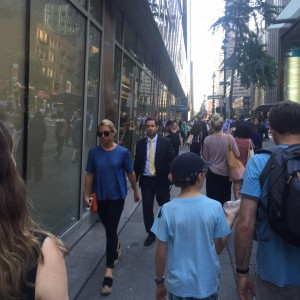 Crowded sidewalk NYC turned