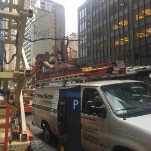 hard jobs placing lights on trees turned